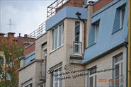 Балкон. Достроен под архитектуру дома.