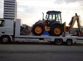 Перевозка тракторов и спец техники низкорамным эвакуатором